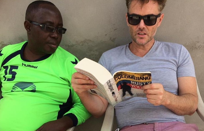 Rusty Young reading some of his book Colombiano to his former San Pedro prison friend Thomas McFadden....
