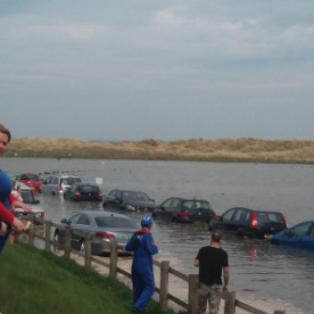 40 cars submerged after high tide at Wales beach car park