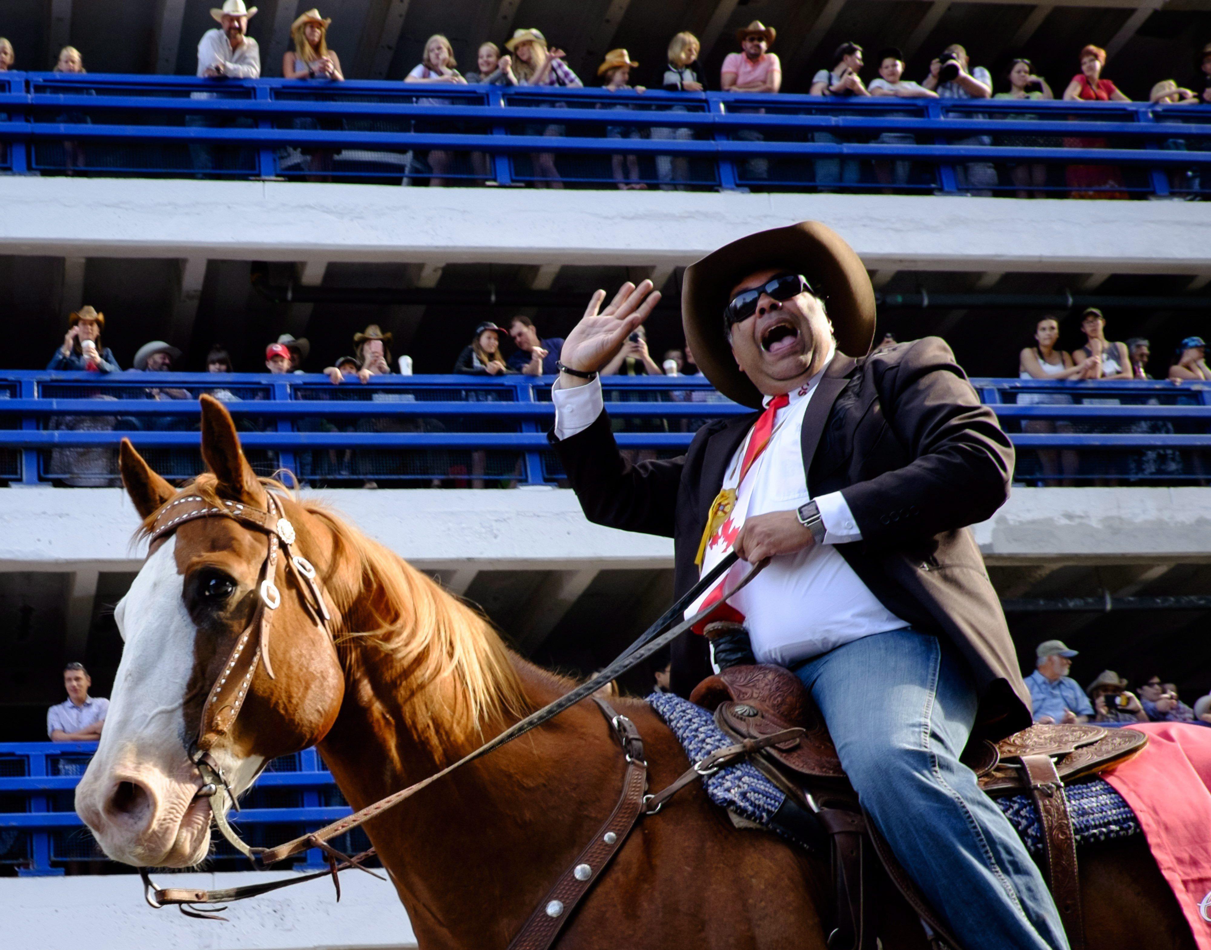 Calgary Mayor Naheed Nenshi rides a horse during the Calgary Stampede parade in Calgary, Friday, July...