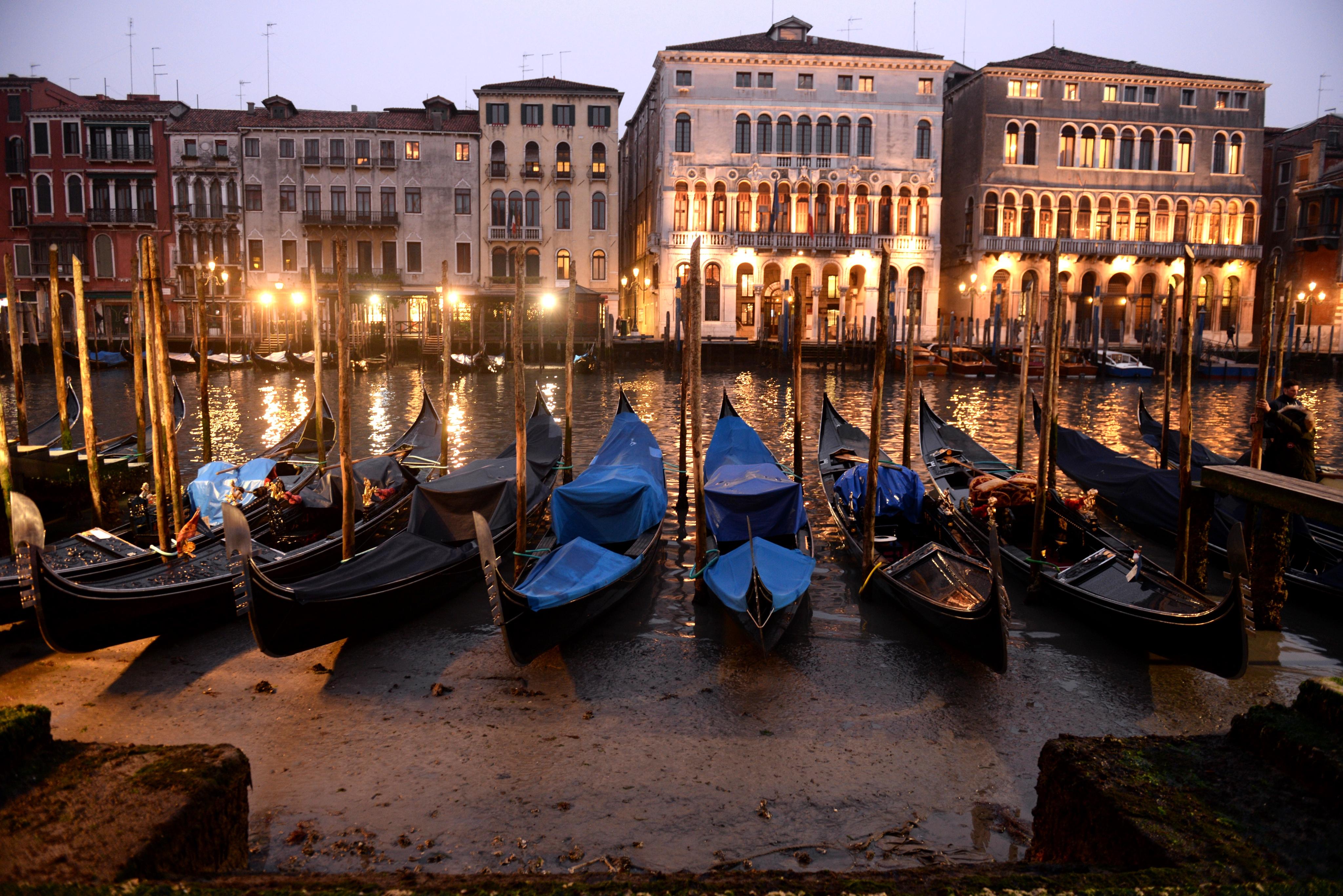 Gondolas are seen tied up in Venice Canal Grande, near Rialto bridge, on January 31, 2018, as exceptionally...