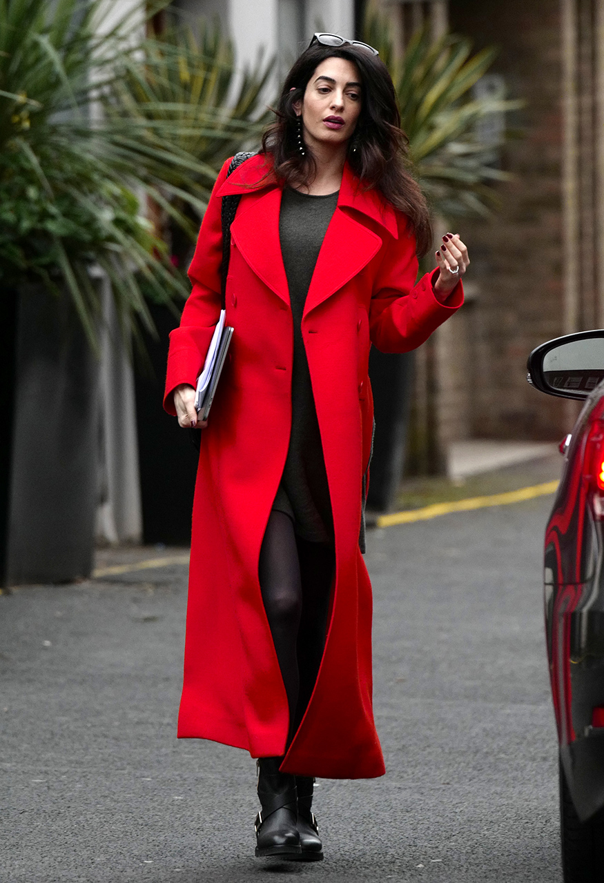 **PREMIUM EXCLUSIVE RATES APPLY** Amal Clooney is seen looking radiant whilst out and about in London. The human rights lawyer looked amazing in a long red wool coat with her pregnant bump on show. Clooney and husband George recently announced that they are expecting twins.