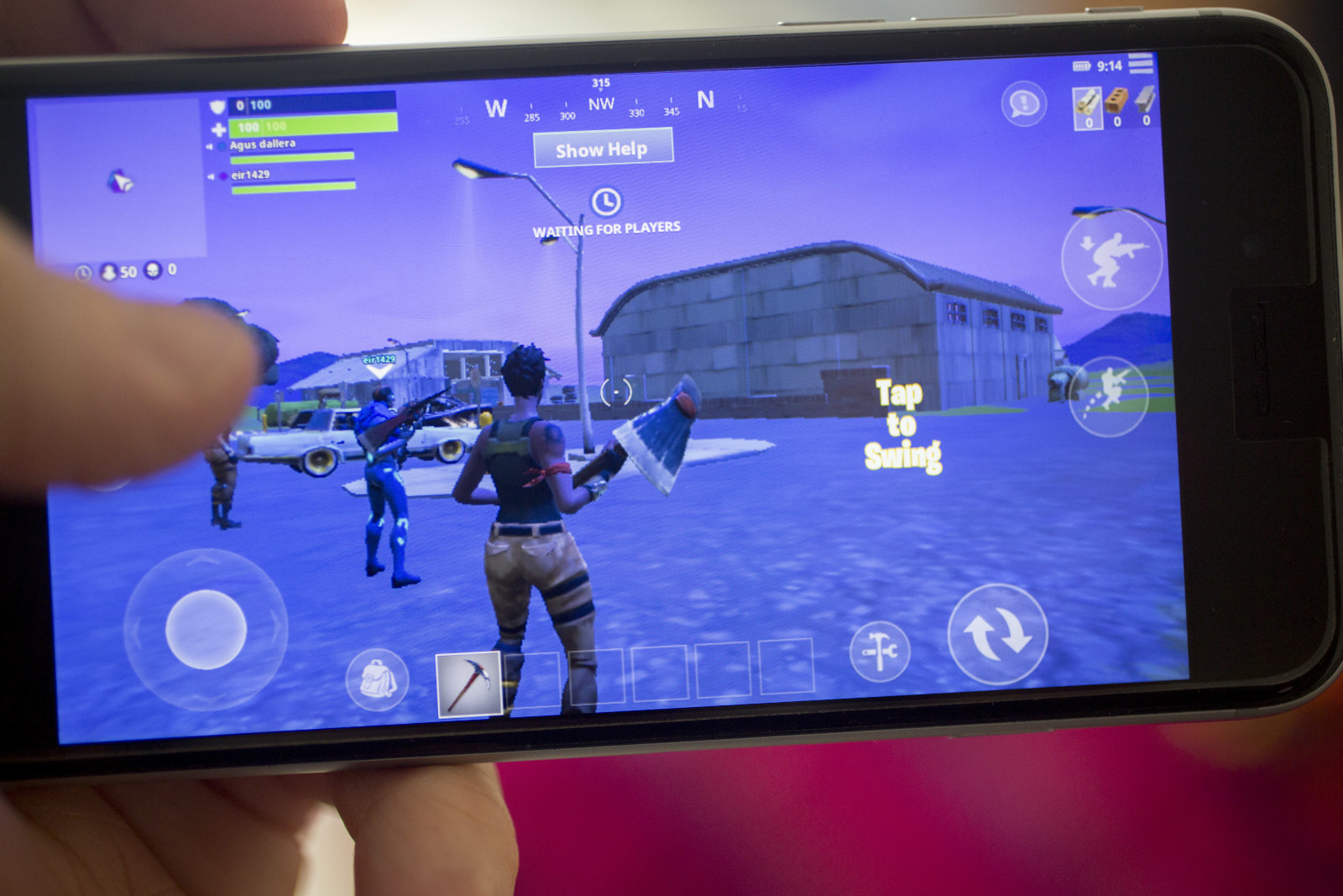 The Epic Games Inc. Fortnite: Battle Royale video game is displayed for a photograph on an Apple Inc. iPhone in Washington, D.C., U.S., on Thursday, May 10, 2018. Fortnite, the hit game that's denting the stock prices of video-game makers after signing up 45 million players, didn't really take off until it became free and a free-for-all. Photographer: Andrew Harrer/Bloomberg via Getty Images