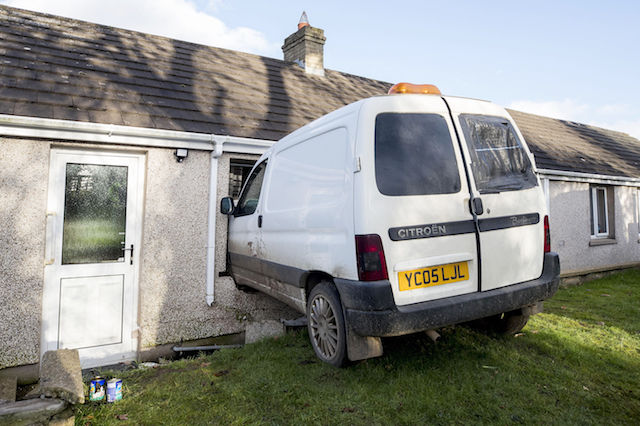 The scene where a van has crashed through the kitchen window of pensioner Annie Burrell's home outside Waringstown, in County Down.