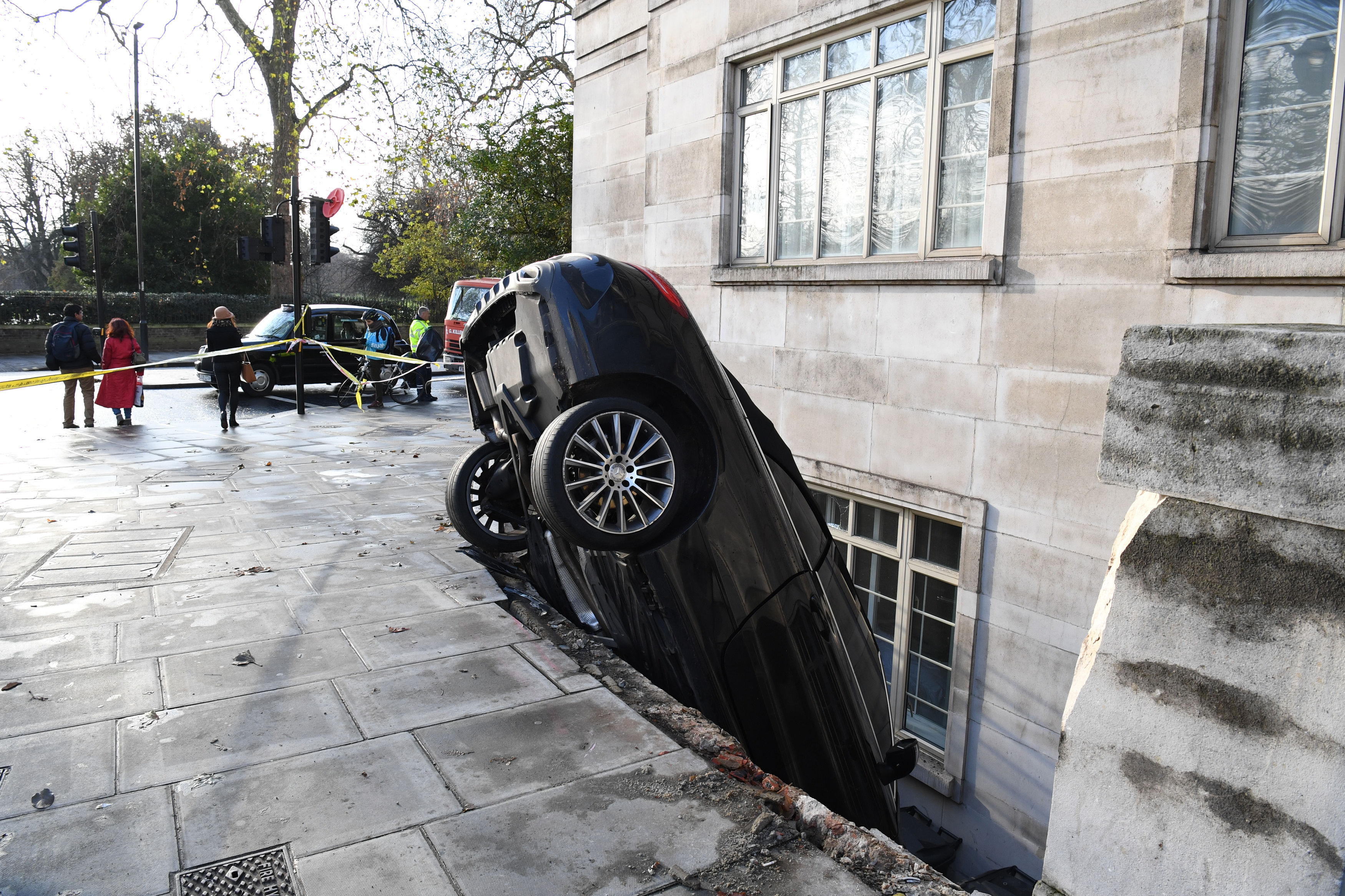 A Mercedes C Class car which crashed through some railings into the basement of a luxury apartment block at Lancaster Terrace, London.