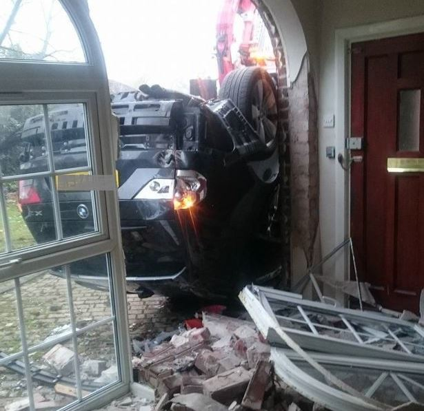 Car crashes into house, insurers say it's not an emergency