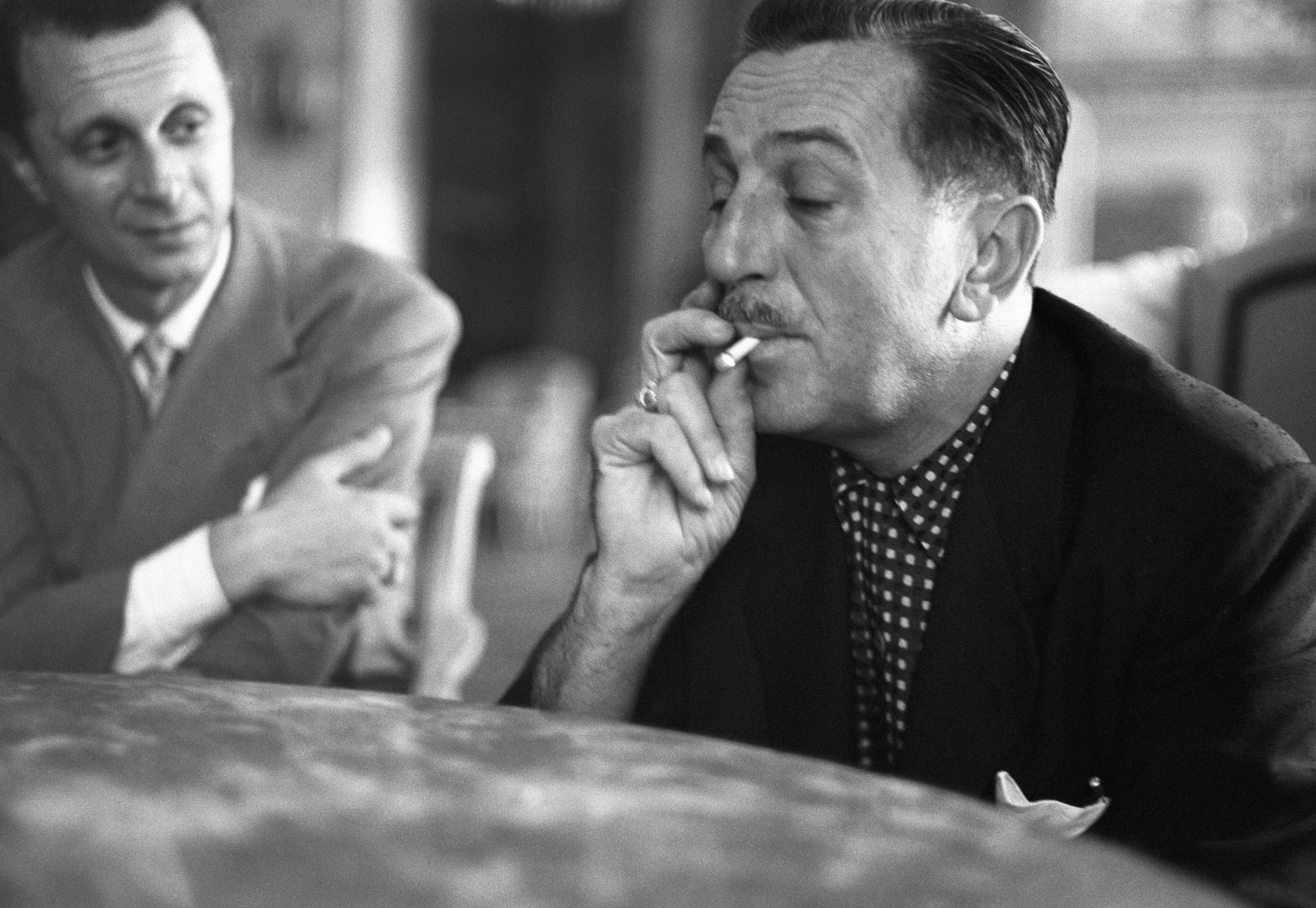 Walt Disney smoking a cigarette