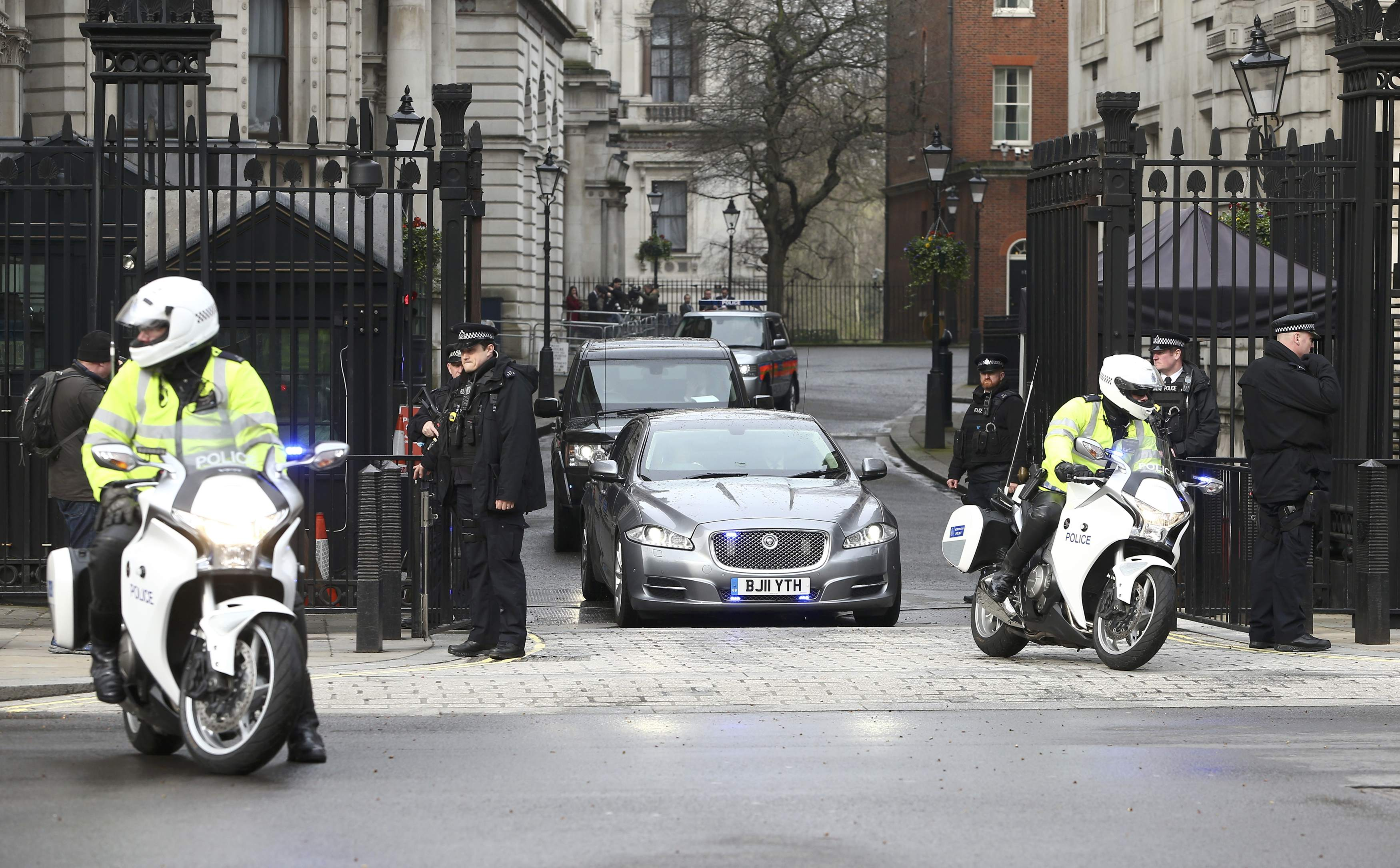 Britain's Prime Minister is driven out of Downing Street the morning after an attack by a man driving...