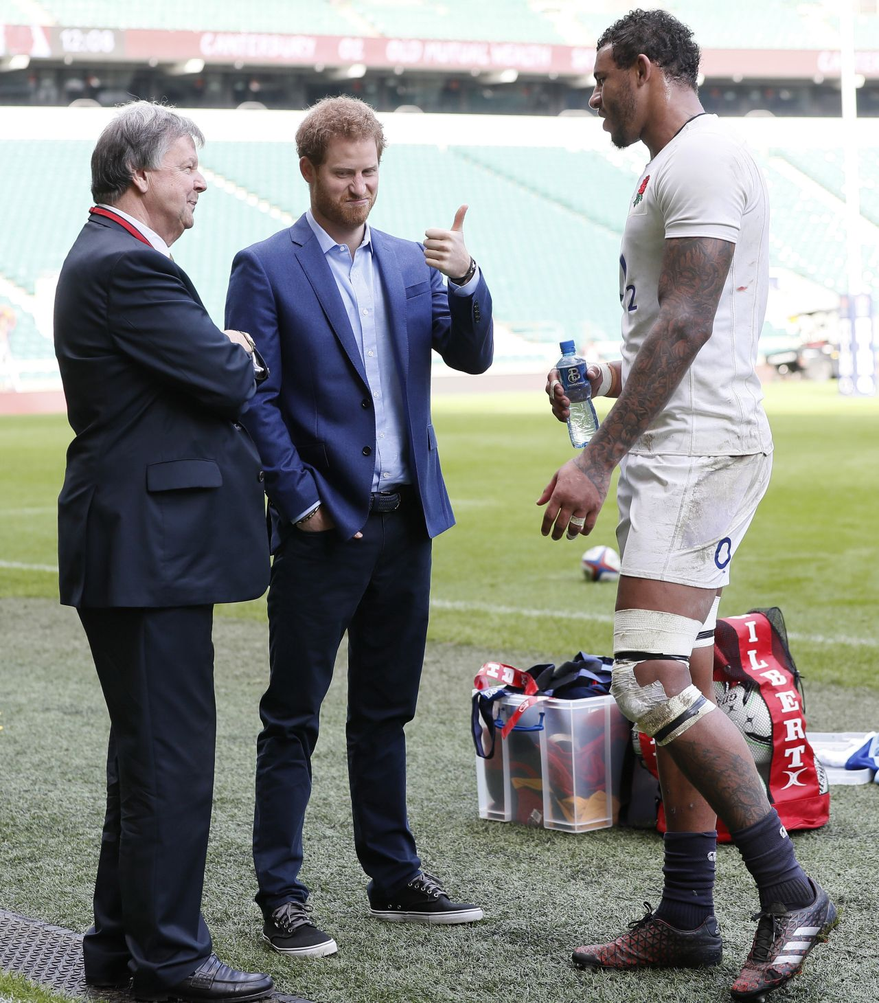 LONDON, ENGLAND - FEBRUARY 17: Prince Harry, (C) speaks with England player Courtney Lawes, (R) and Ian Richie, CEO of the RFU, during a visit to an England Rugby Squad training session at Twickenham Stadium on February 17, 2017 in London, England. In his new role as Patron of the Rugby Football Union (RFU), Prince Harry attended the England rugby team open training session. (Photo by Kirsty Wigglesworth - WPA Pool/Getty Images)