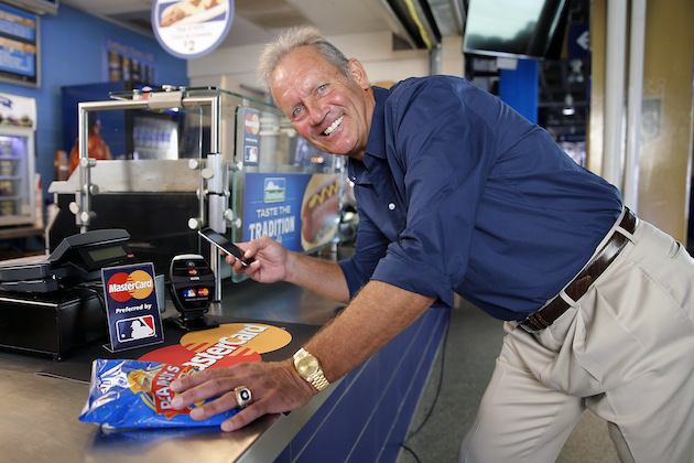 Major League Baseball Hall of Famer George Brett makes ceremonial first payment using Apple Pay with MasterCard prior to the 2014 World Series at Kauffman Stadium on Monday, Oct. 20, 2014 in Kansas City, Mo. (Photo by G. Newman Lowrance/Invision for MasterCard/AP Images)