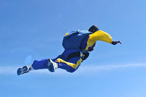 Mandatory Credit: Photo by Leon Schadeberg/REX (442290k) World record mass freefall jump landing at Sanam Luang Royal Ceremonial grounds. The record was made by 672 people. WORLD RECORD SKYDIVE, BANGKOK, THAILAND - 24 JAN 2004