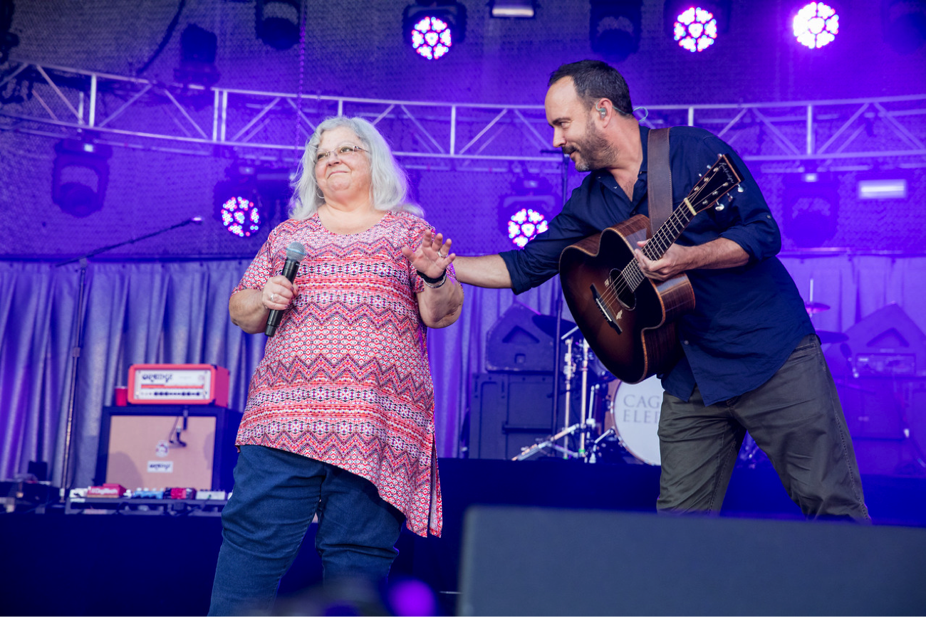 Dave Matthews welcomes Susan Bro onto the stage.