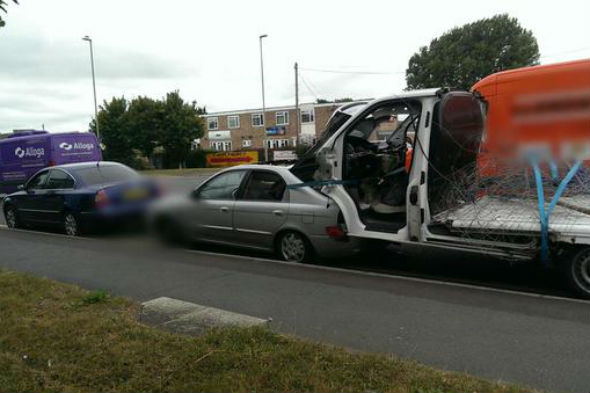 Police Stop Car Towing Another Car With A Van Wedged In The Boot Aol