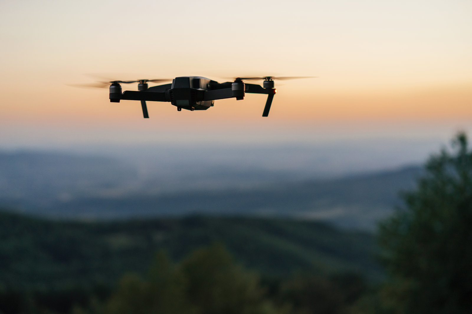 Flying drone at dusk