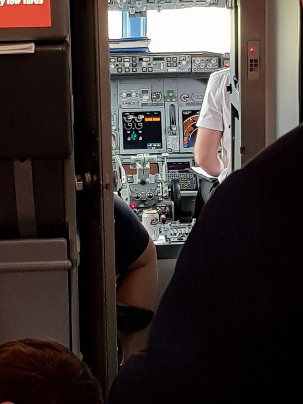 Passenger spots can of beer in plane cockpit