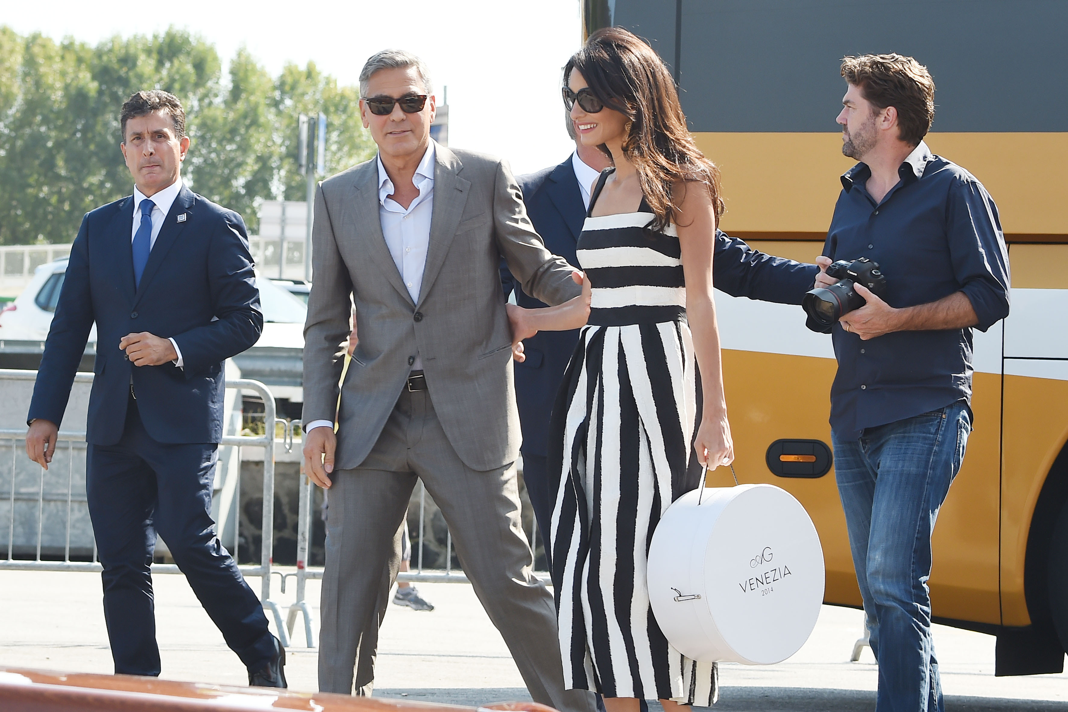 George Clooney and Amal Alamuddin are dazzling as they arrive in Venice