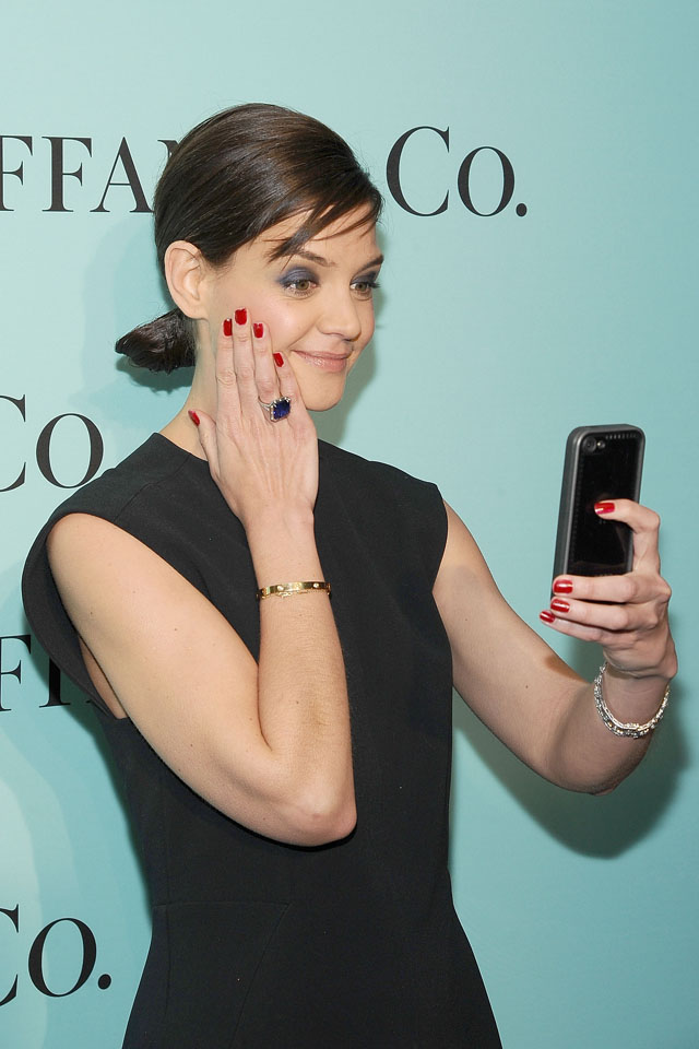 NEW YORK, NY - APRIL 10:  Katiie Holmes takes a 'selfie' while attending the 2014 Tiffany's Blue Book Gala at the Guggenheim Museum on April 10, 2014 in New York City.  (Photo by Gary Gershoff/WireImage)