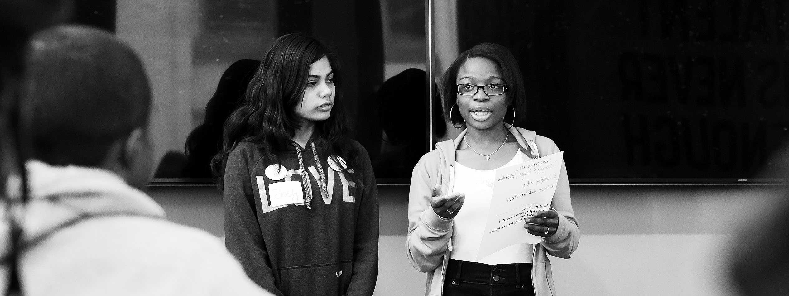 Two students of color giving a presentation