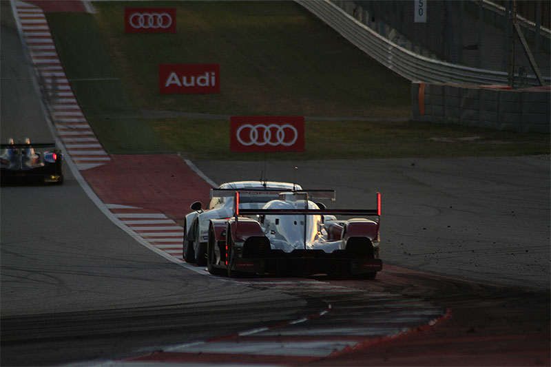 The Audi R18 E-Tron Quattro races at dusk in the 2015 Lone Star Le Mans.