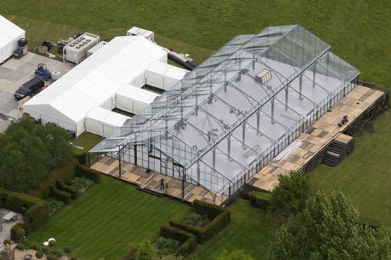Aerials views of the Middleton family home in Bucklebury, UK as seen a few days before Pippa Middleton's wedding to James Matthews.   A gigantic conservatory-style marquee dominates the surrounding gardens and technicians can be seen fitting large lights. There are also two adjoining large marquees in the grounds, some temporary toilets for workers and various vehicles and rigging boxes stacked nearby.   Also seen in the photos are aerial shots of St Mark's Church and the Englefield Estate where Pippa will marry her fiance before heading back to her family home for the lavish reception this Saturday, May 20th.  Pics shot May 16th.  <P> Pictured: Middleton family home <B>Ref: SPL1498984  160517  </B><BR/> Picture by: Jenkins/Sirc/Splash News<BR/> </P><P> <B>Splash News and Pictures</B><BR/> Los Angeles: 310-821-2666<BR/> New York: 212-619-2666<BR/> London: 870-934-2666<BR/> photodesk@splashnews.com<BR/> </P>