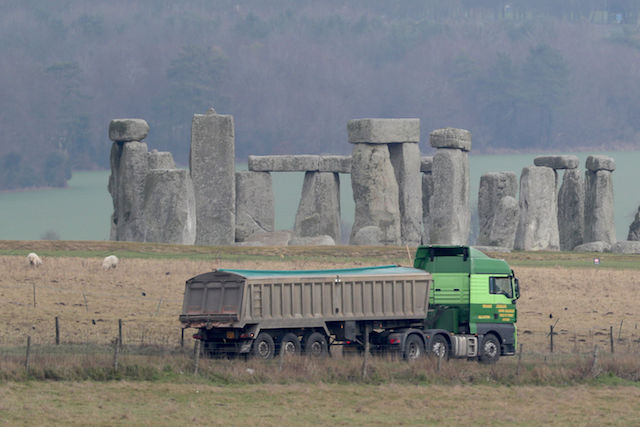 Traffic passes Stonehenge on the A303 road in Wiltshire, as Highways England is holding a public consultation on its plans for putting the A303 into a 1.8-mile (2.9km) dual carriageway tunnel where it passes the ancient stone circle to cut congestion and improve the surroundings.