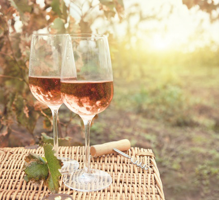 29018748 - two glasses of the rose wine in autumn vineyard. harvest