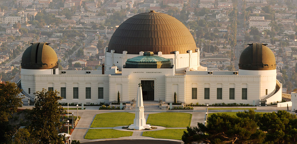 A front view of Griffith Observatory sitting above Hollywood in Griffith Park