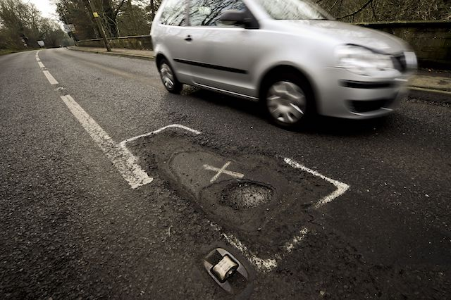 Cars pass a deep potholed road in Gloucestershire, which along with most of the South West UK, needs attention and repair work after a year of heavy rainfall and recent flooding, creating potholes and debris. PRESS ASSOCIATION Photo. Picture date: Sunday January, 6, 2013. Photo credit should read: Ben Birchall/PA Wire