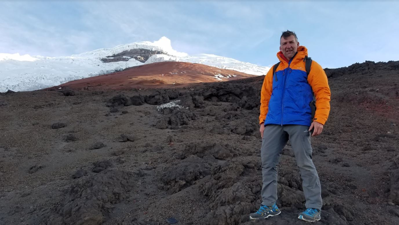Tim on a glacier-capped mountain in