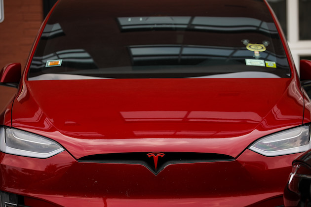 tesla-cars-sit-parked-outside-a-tesla-de