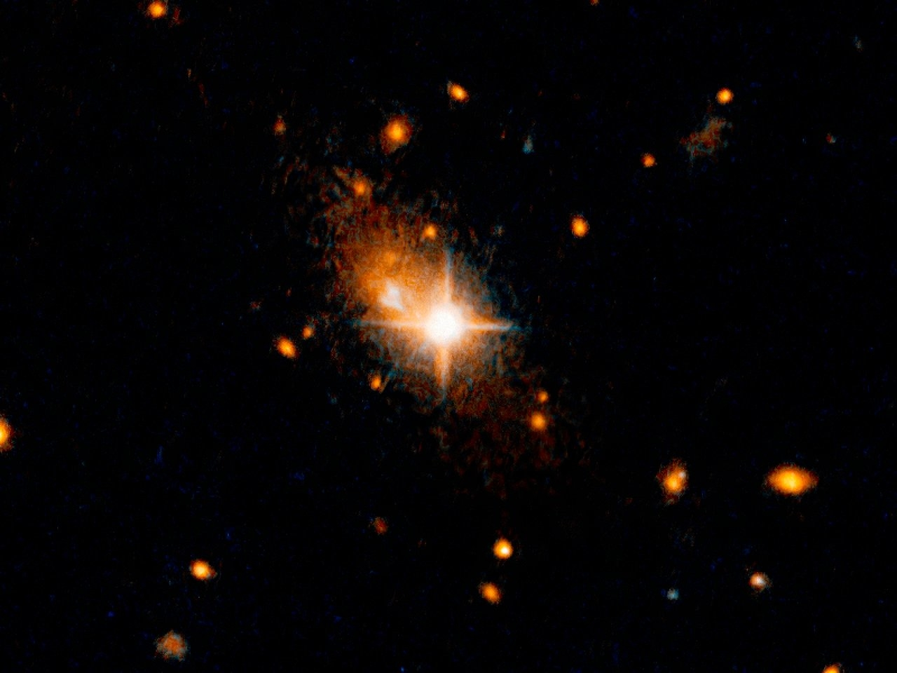 The galaxy 3C186, located about 8 billion years from Earth, is most likely the result of a merger of two galaxies. This is supported by arc-shaped tidal tails, usually produced by a gravitational tug between two colliding galaxies, identified by the scientists. The merger of the galaxies also led to a merger of the two supermassive black holes in their centres, and the resultant black hole was then kicked out of its parent galaxy by the gravitational waves created by the merger. The bright, star-like looking quasar can be seen in the centre of the image. Its former host galaxy is the faint, extended object behind it.