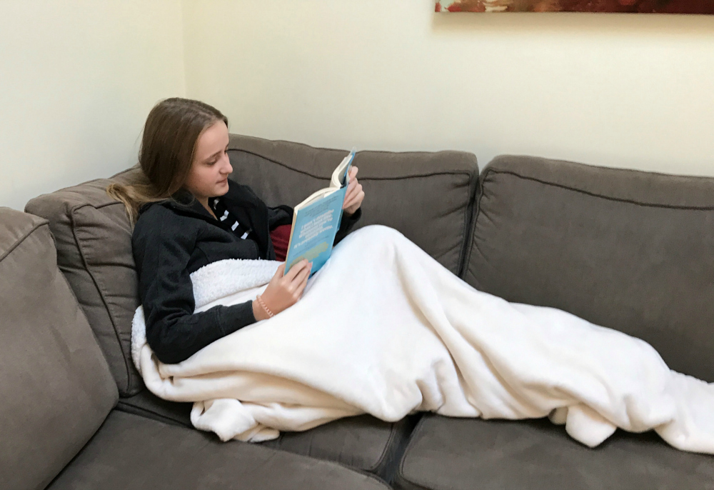 Now-13 year-old Sophie reading