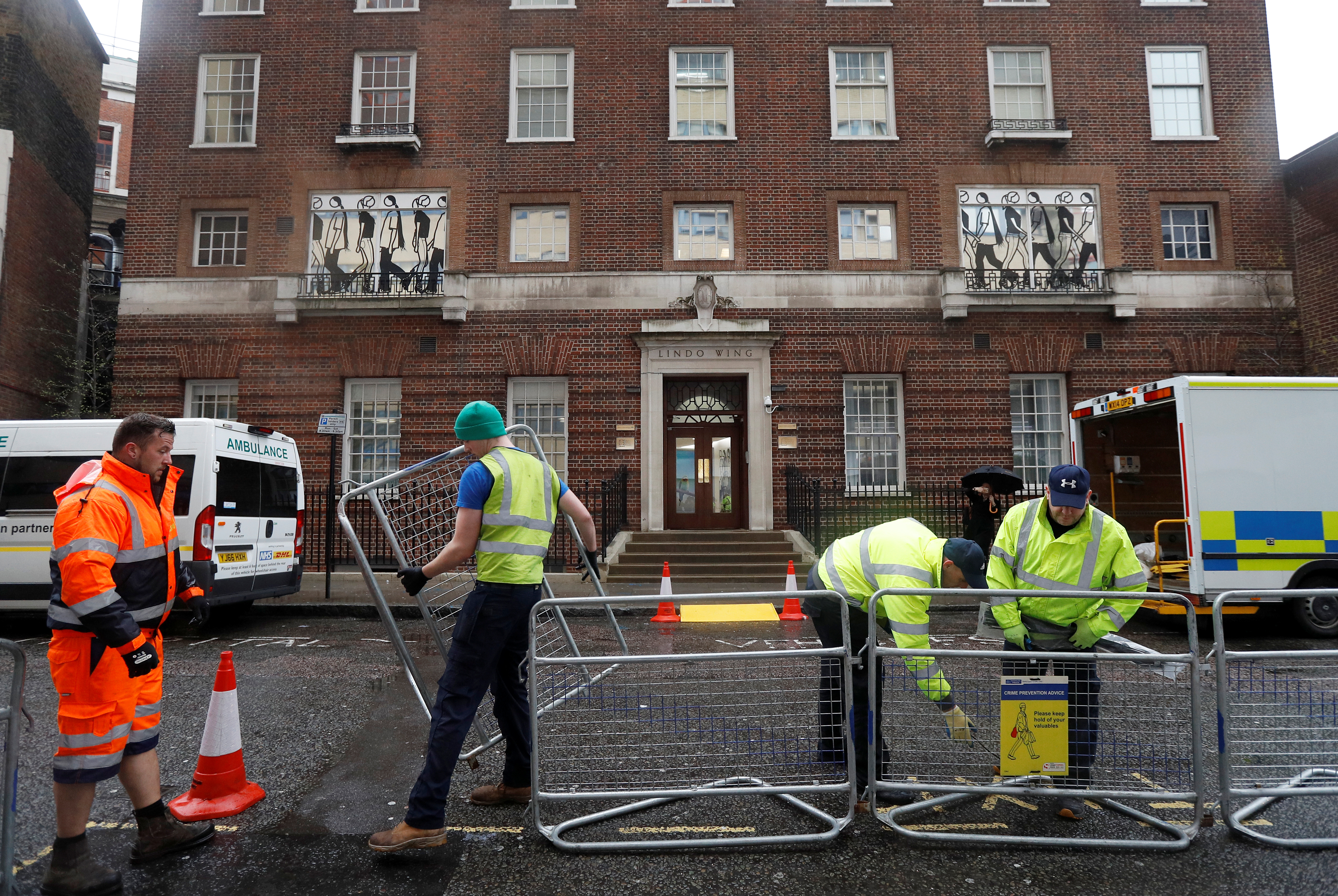 Workers build a media pen opposite the entrance to the Lindo Wing of St Mary's hosital where Britain's...
