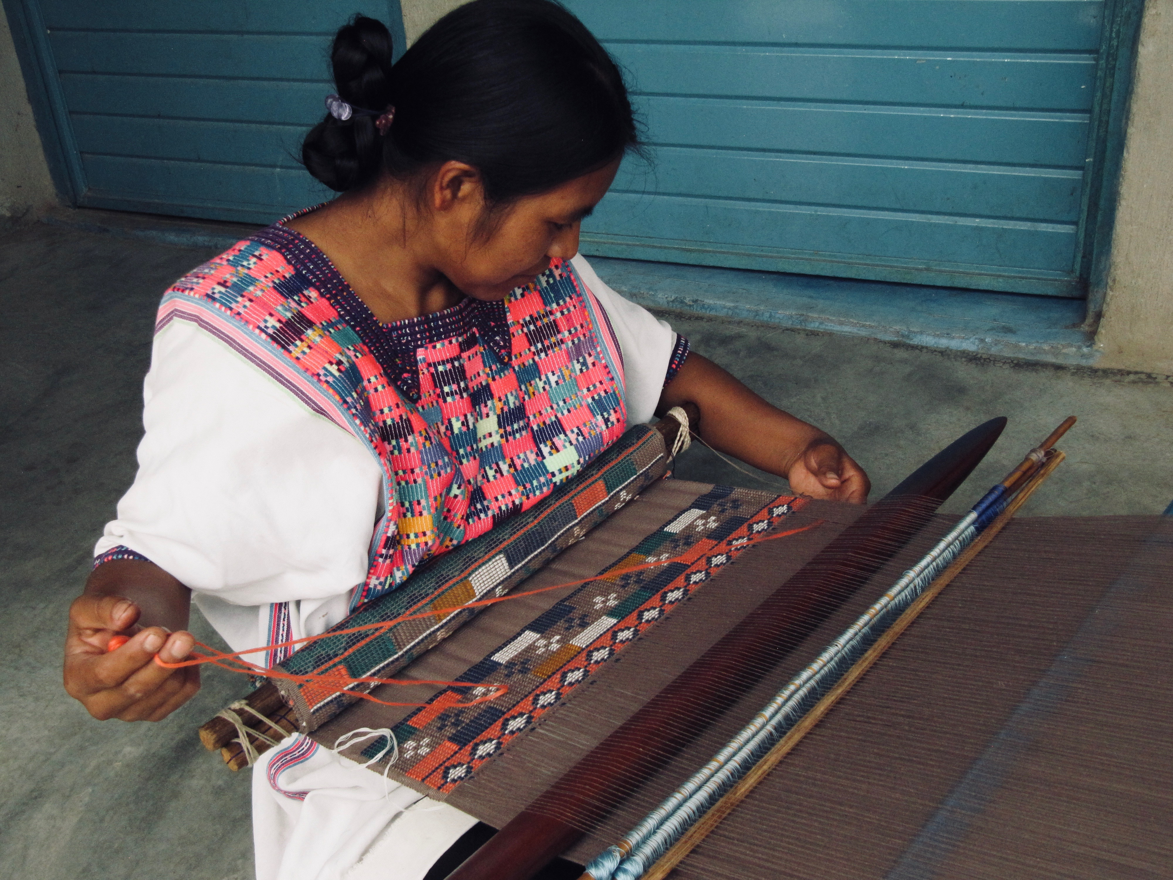 Anita, from Chiapas, creating the fabric for a cap using a backstrap