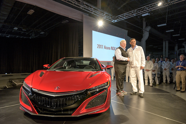 From left, Rick Hendrick, owner of Hendrick Motorsports and Hendrick Automotive Group, takes delivery of 2017 Acura NSX, VIN 001, from Acura NSX Engineering Large Project Leader Clement D'Souza.