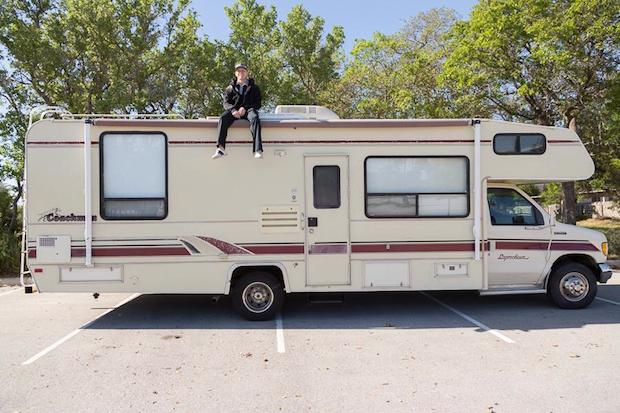 Heath Padgett sits atop the RV he and his wife Alyssa use for the