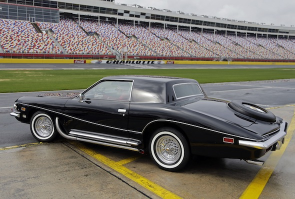Dale Earnhardt Jr. takes Elvis Presley's 1973 Stutz Blackhawk III onto the track for a few laps after a news conference at Charlotte Motor Speedway in Concord, N.C., Tuesday, March 25, 2014. The car, the last car Presley drove before his death, will be the centerpiece of an exhibit during the AutoFair at the track from April 3-6. (AP Photo/Chuck Burton)