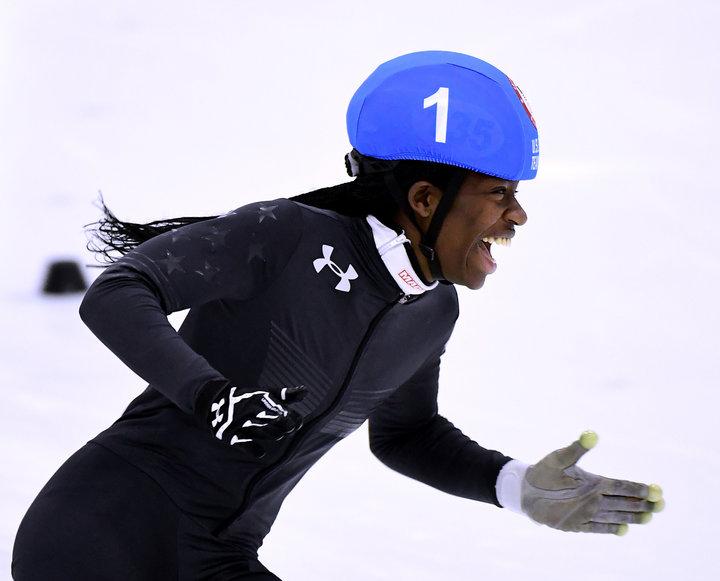 Biney célébrant sa victoire pendant les essais de l'équipe olympique en décembre