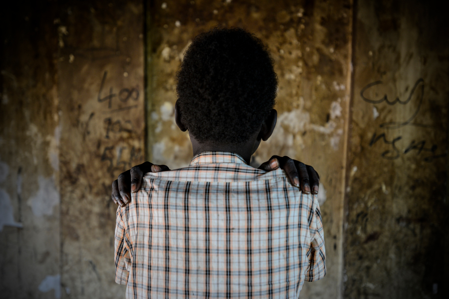 Luny (name changed), 14, was recently released from an armed group in South Sudan. He's seen in the Protection...