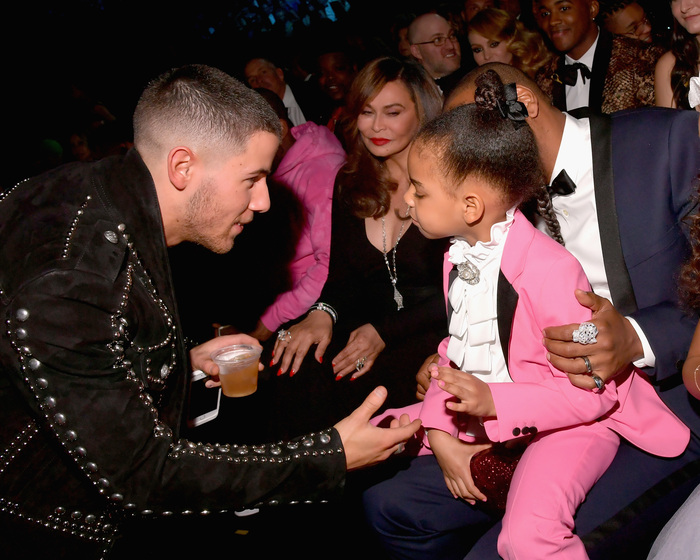 LOS ANGELES, CA - FEBRUARY 12:  Singer-songwriter Nick Jonas (L) and Blue Ivy Carter during The 59th GRAMMY Awards at STAPLES Center on February 12, 2017 in Los Angeles, California.  (Photo by Lester Cohen/Getty Images for NARAS)