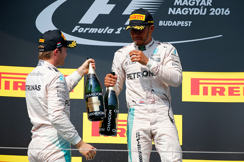 Hungarian Grand Prix 2016 - Hungaroring, Hungary - 24/7/16 Mercedes' Lewis Hamilton and Nico Rosberg celebrate after the race.