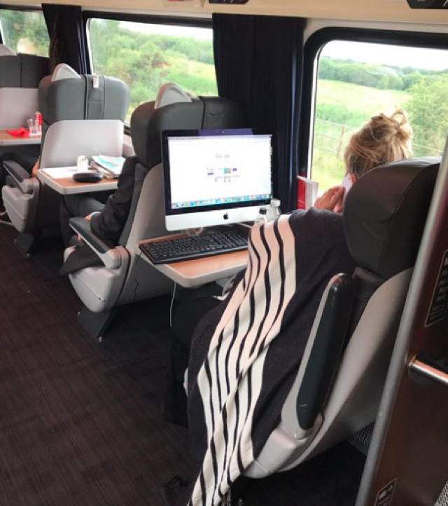 Commuters surprised as woman brings desktop onto train
