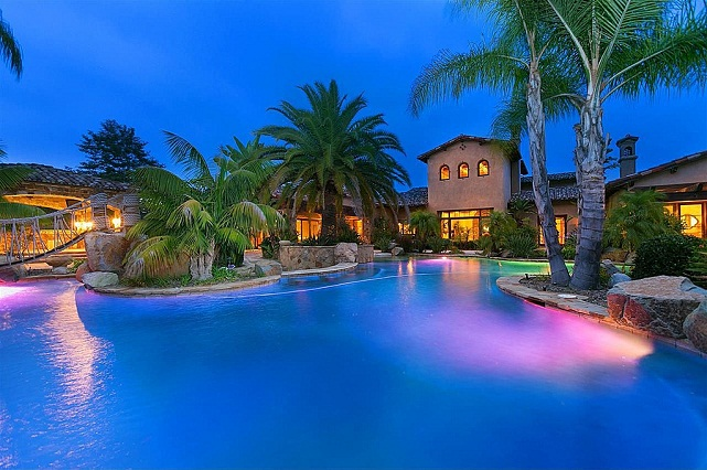 Mansion with pool at night  Back on the Market: Football Star's Mansion With Hidden Room - AOL ...