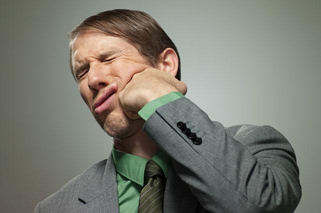Man punching himself in face