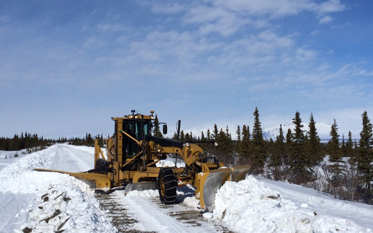 A state transportation worker clears snow off the Denali Highway in Alaska in 2015 as part of an annual spring opening of the 135-mile road. Photo courtesy of Alaska Department of Transportation & Public Facilities.