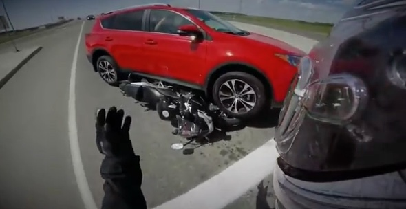Helmet cam captures moment car drives over motorbike (video)