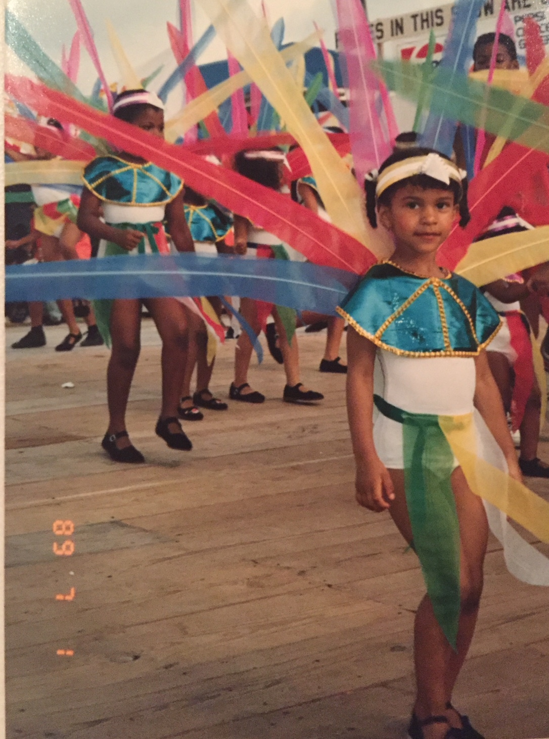 Mischka Crichton at age three playing mas at the St. Vincent Carnival in