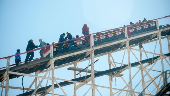 Theme park visitors climb off rollercoaster that broke down midair