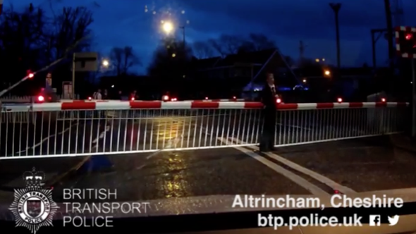 Boy runs across train tracks as level crossing barriers close and gets stuck