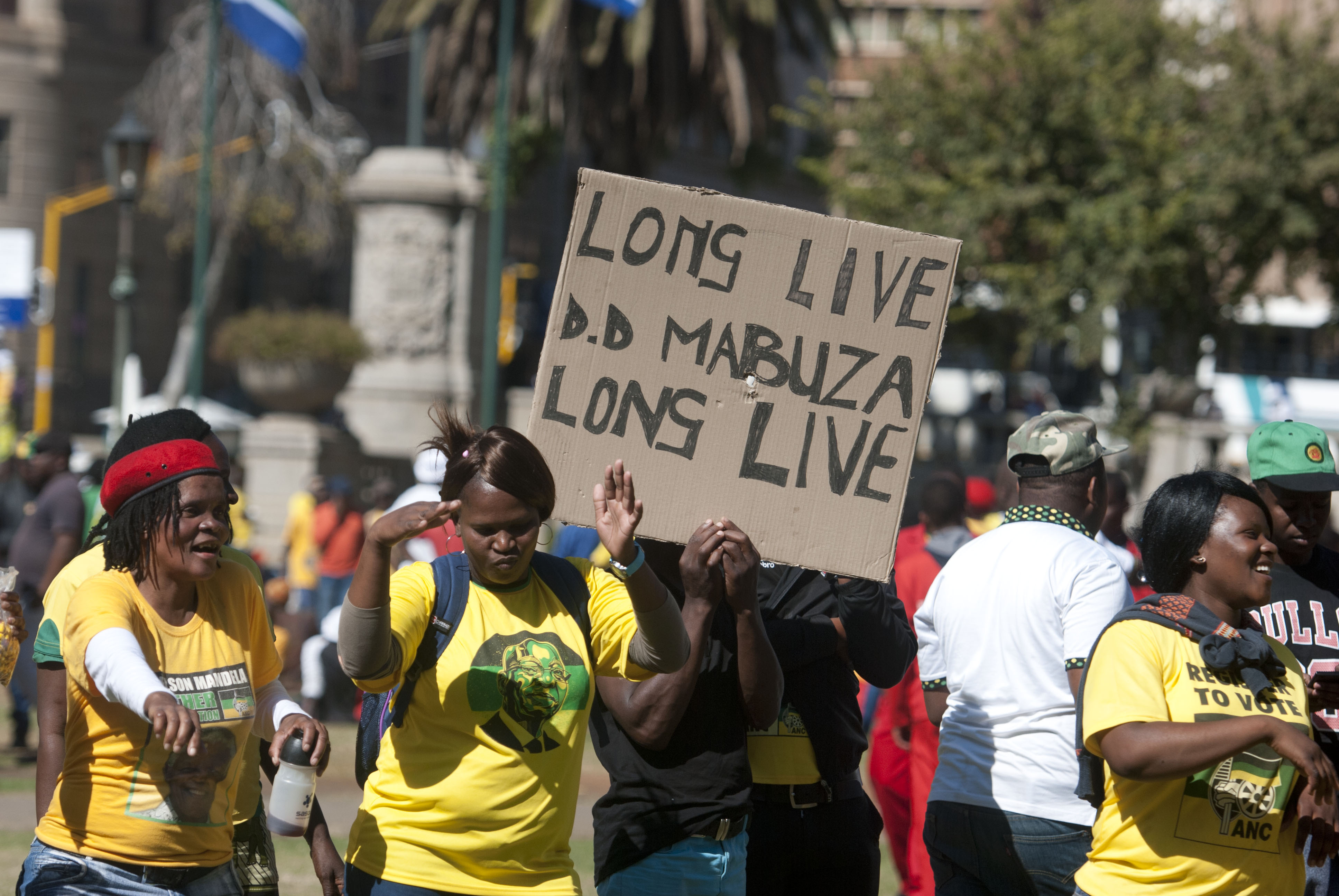 African National Congress (ANC) members gather outside the North Gauteng High Court in support of the...