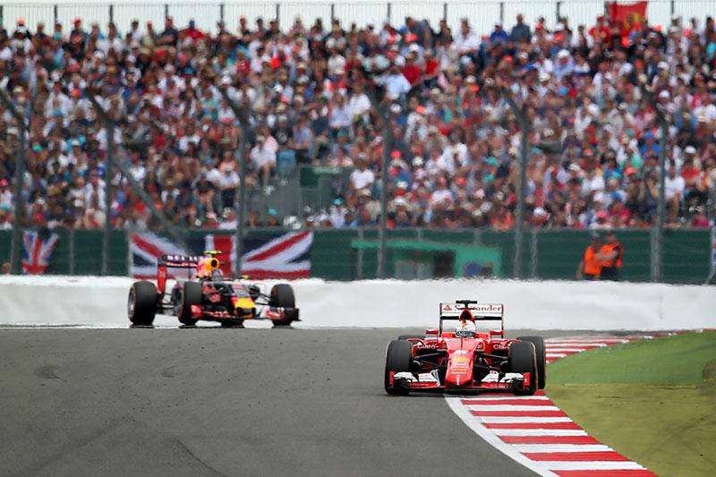Sebastian Vettel drives ahead of Daniil Kvyat at the 2015 British Grand Prix.